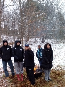 Our amazing volunteers: teens from  the Weston High National Honors Society and farm-stand  frequenter, Amanda...keeping warm by the fire :)